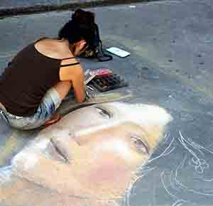 Girl drawing on ground Mobile